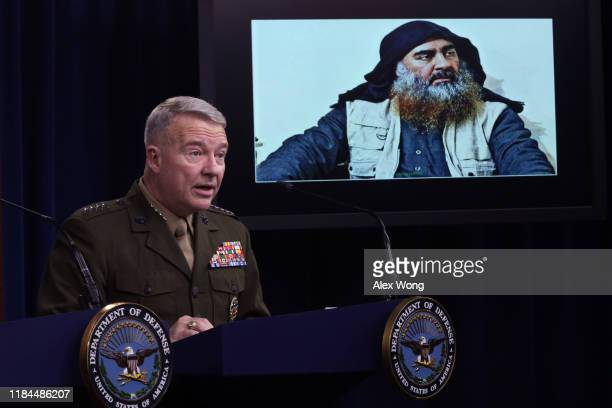 Marine Corps Gen. Kenneth McKenzie, commander of U.S. Central Command, speaks as a picture of Abu Bakr al-Baghdadi is seen during a press briefing...