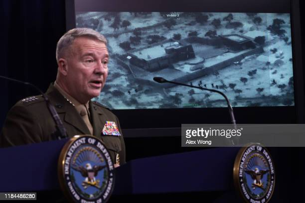 S Marine Corps Gen Kenneth McKenzie commander of US Central Command speaks as a picture of the operation targeting Abu Bakr alBaghdadi is seen during...