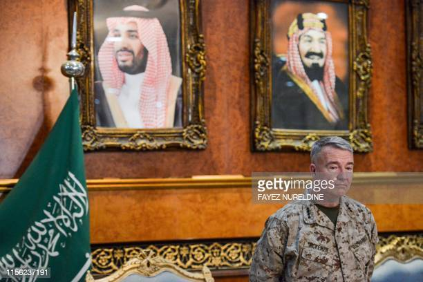 US Marine Corps General Kenneth F McKenzie Jr Commander of the US Central Command poses for a picture while standing before a portrait of Saudi...