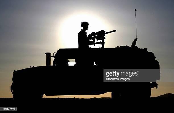 A US Marine Corps gunner mans an MK-19 40mm Machine Gun mounted on a High Mobility Multi-purpose Wheeled Vehicle