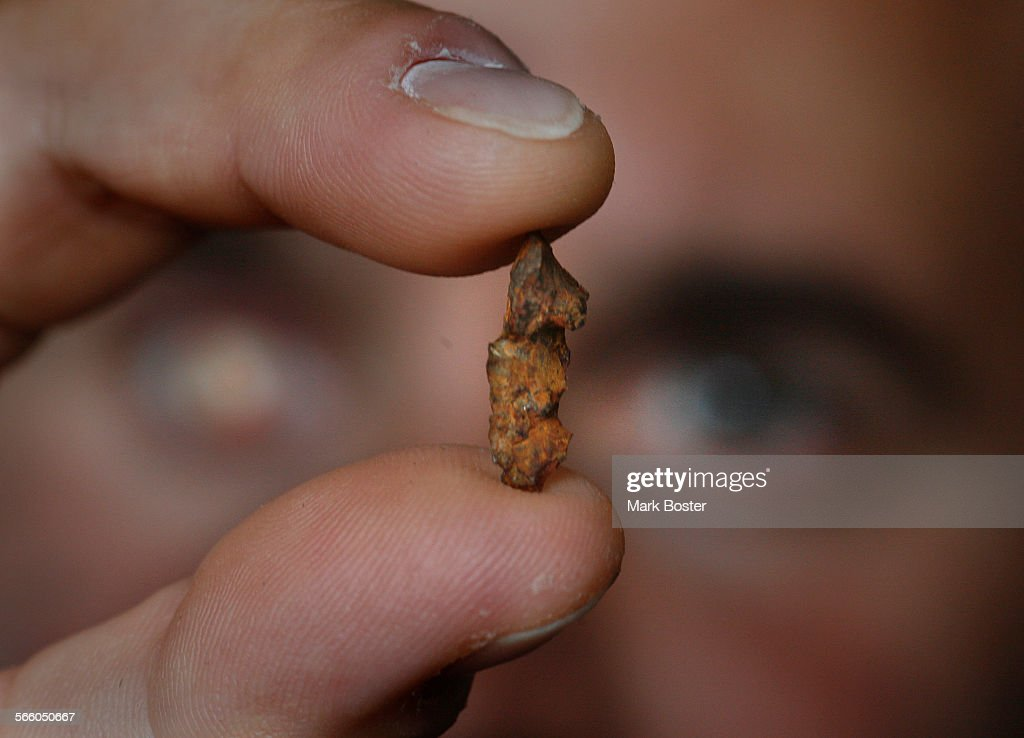 Marine Corps Gunnery Sergeant (ret) Nick Popaditch holds a piece of ...