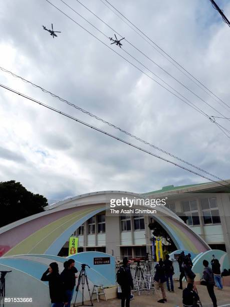 US Marine Corps helicopters fly over the Futenma Daini Elementary School on December 13 2017 in Ginowan Okinawa Japan A metal window frame fell from...