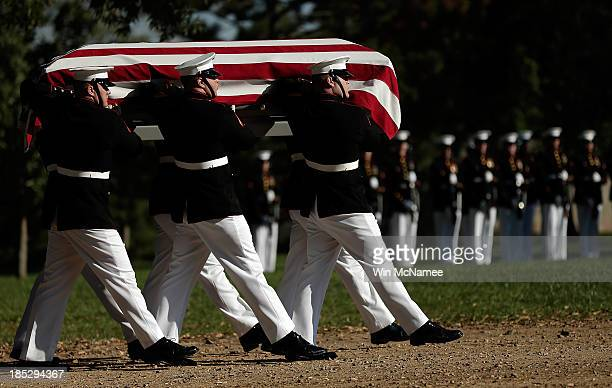Marine Corps honor guard carry the caskets containing the remains of Staff Sgt. Thomas Meek and Capt. Henry White who were laid to rest at Arlington...