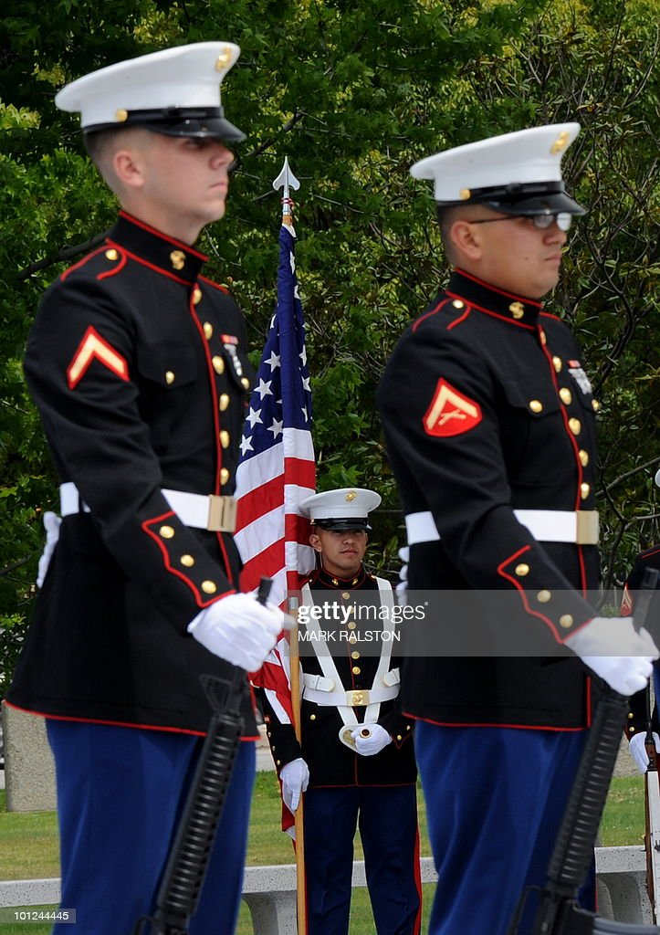 Marine Corps honor guard stands to attention during a memorial service for Special Agents and their law enforcement and military colleagues killed in the line of duty, at the Federal Building in Los Angeles on May 28, 2010. Memorial Day, which was formerly known as Decoration Day, commemorates U.S. men and women who died while in the service to their country and was first enacted to honor Union soldiers of the American Civil War. AFP PHOTO/Mark RALSTON