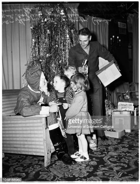 Marine Corps League Christmas Party, 23 December 1951. Mel Coffey, child;Janice Brown, child;Jane Christine Pinkston, child;Private First Class...