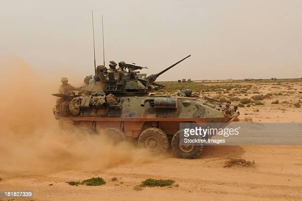 A Marine Corps Light Armored Vehicle kicks up a cloud of dust.