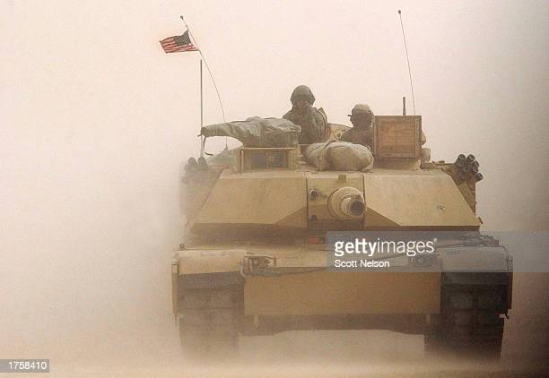 S Marine Corps M1/A1 Abrahms tank rolls on despite a blinding sand storm during exercises February 3 2003 near the Iraqi border in Kuwait The M1/A1...