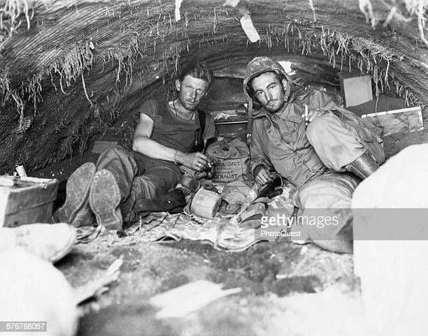 US Marine Corps motion picture cameramen Sgt WA Genaust and Corporal Atlee S Tracy Iwo Jima February 24 1945 Genaust was the cameraman who filmed in...