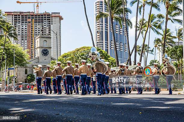 US Marine Corps Pacific Fleet Band in military uniform marching and playing in the annual local downtown King Kamehameha Day Parade in Honolulu...