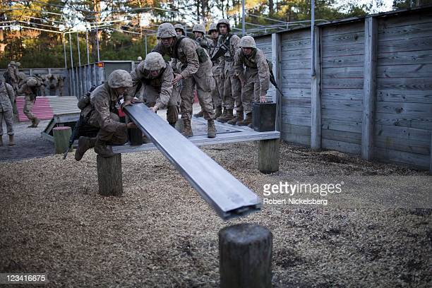 Marine Corps recruits go through a team problem solving drill during the 54hour Crucible exercise January 7 2011 at the Marine Corps Recruit Depot on...