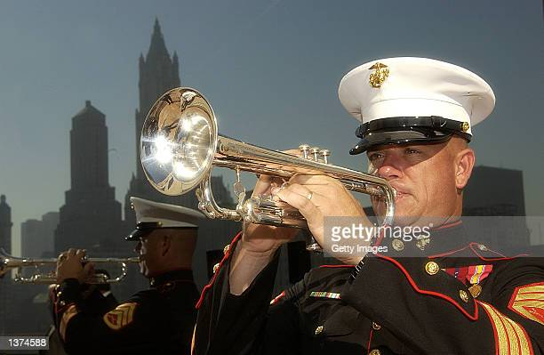Marine Corps Staff Sergeant Joseph Streeter of the Marine Corps Band in Quantico Virginia prepares to play Taps at a flag raising ceremony on the...