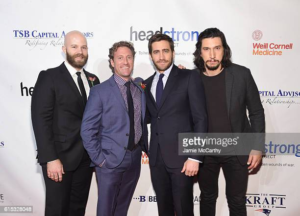 Marine Corps Veteran actor Caleb Wells Founder of Headstrong Project Zach Iscol actors Jake Gyllenhaal and Adam Driver pose for a photo together as...