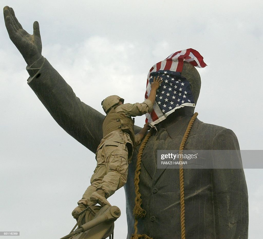 A US Marine covers the face of Iraqi Pre : News Photo
