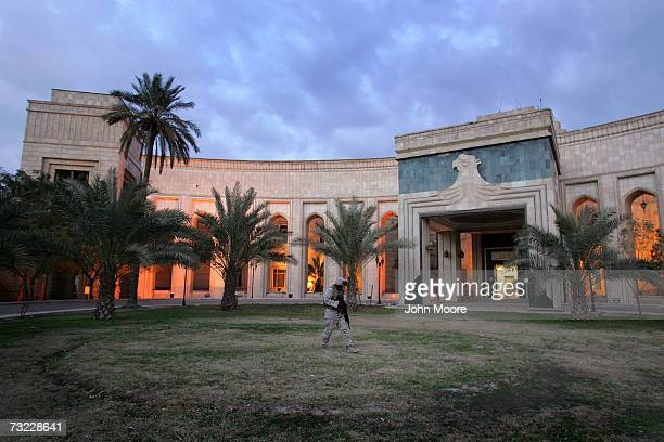 Marine Cpl. Chilet Paul from Miami, Florida, walks past the American Embassy February 5, 2007 in Baghdad, Iraq . The platoon of Marines from the...