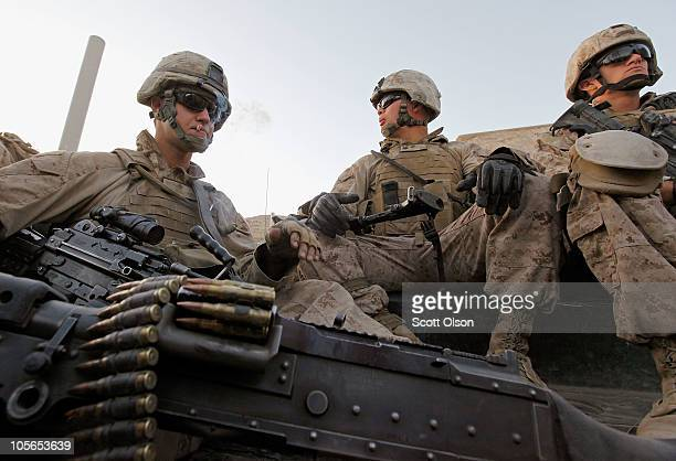 S Marine Cpl Clayton Foss of Elsworth ME US Navy corpsman HM3 Michael Pepper of Detroit MI and Marine Sgt Dillon Paulus of Douglasville GA with India...