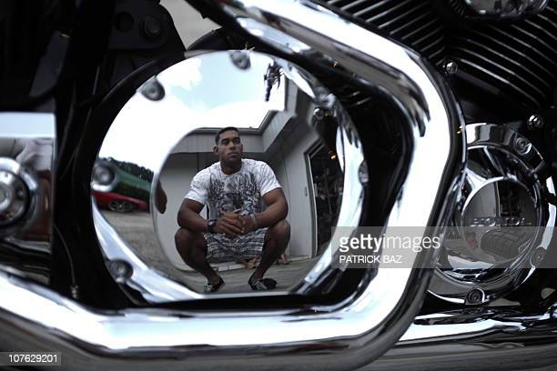US Marine Cpl Derek Nelson with 1/3 Charlie Company reflects in the chromed engine of his motorbike on the Hawaiian island of Oahu on June 18 2010...