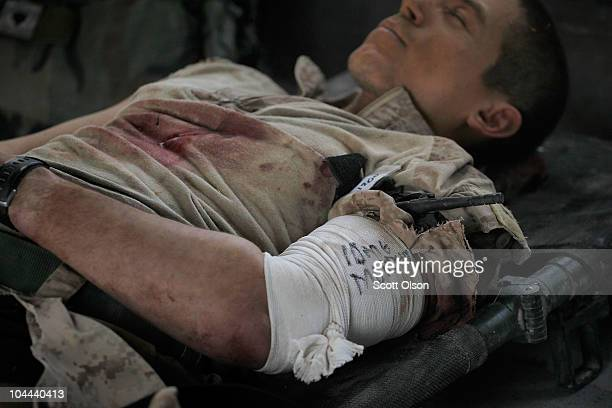 S Marine Cpl Joel Martinez of Magnolia TX is treated for his wounds aboard a MEDEVAC helicopter on September 23 2010 near Marja Afghanistan Martinez...