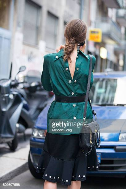 Marine Deleeuw wears a backwardsstyle buttonup shirt and a low pony tail from the show outside the N21 show during Milan Fashion Week Spring/Summer...
