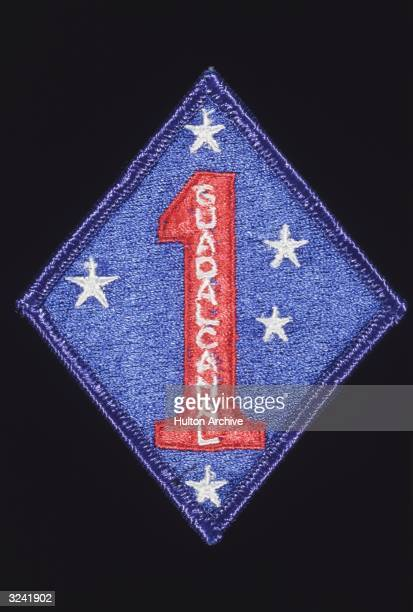 Marine division patch from World War II commemorating the American assault on the Japanese military base on Guadalcanal in the Solomon Islands on 7th...