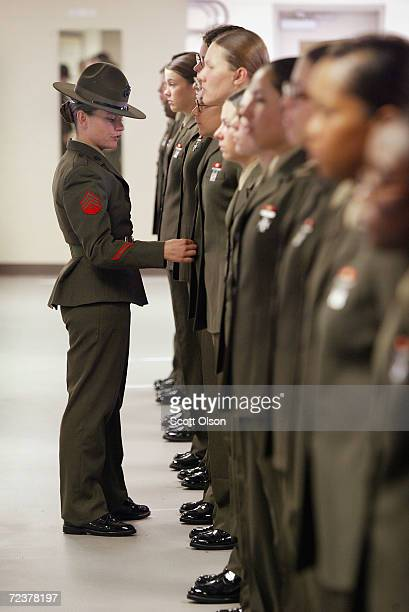 Marine drill instructor Sgt Sheryl Wilhoit of Petaluma California inspects her female recruits during training at the United States Marine Corps...