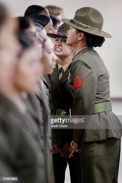 Marine drill instructors Sgt Jennifer Kelton of McAlister Oklahoma and SSgt Marie Michael of West Valley New York discuss a problem with one of their...