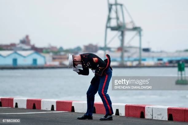 Marine ducks into Marine One's rotor wash at the Wall Street heliport May 4, 2017 in New York during the arrival of US President Donald Trump. -...