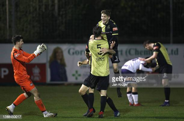 Marine FC players celebrate winning the match after the final whistle during the Emirates FA Cup Second Round match between Marine FC and Havant and...