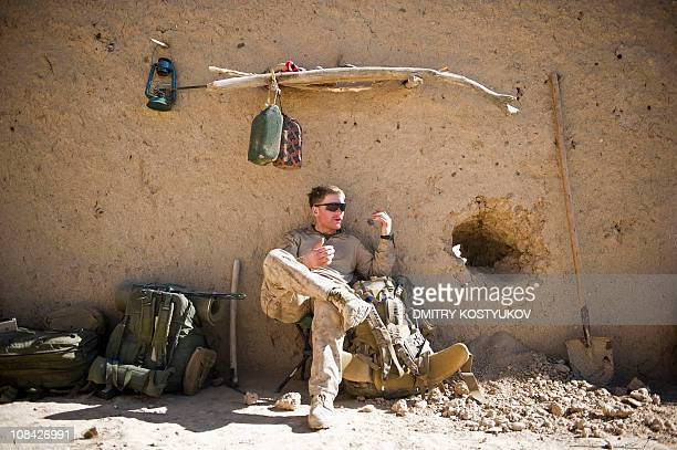 Marine from 1st Battalion 8th Bravo company rests in a compound not far from Shir Chazay in Musa Qala district of Helmand province on January 22 2011...