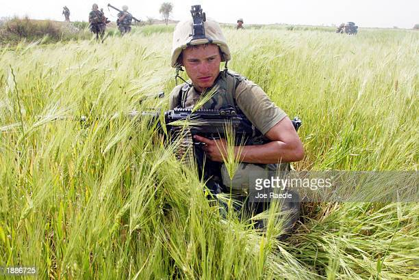 Marine from Task Force Tarawa patrols a wheat field in search of enemy combatants or stockpiles of weapons March 31, 2003 in the southern Iraqi city...