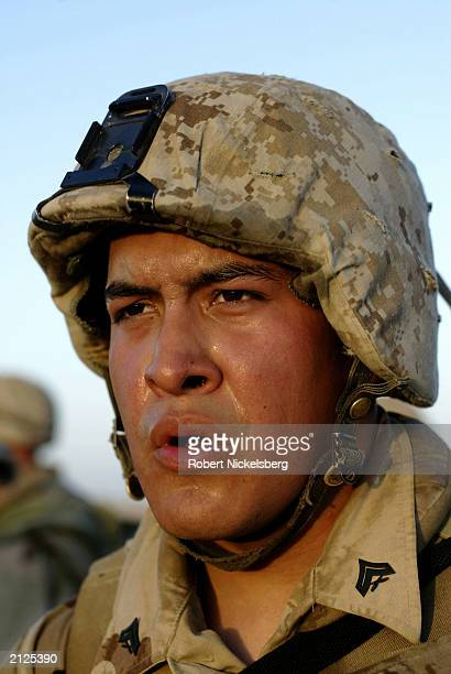 Marine from the 1st Marine Division, 7th Regiment, sweats after an early morning five mile run March 14, 2003 at Life Support Area 7 , in the desert...