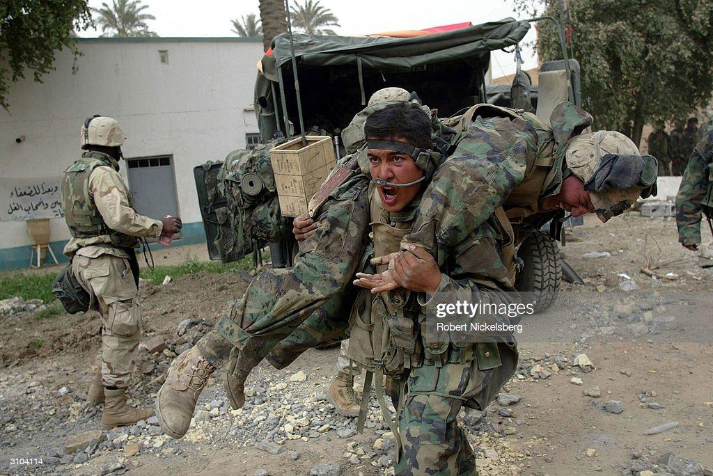 U.S. Marines Hit By Iraqi Artillery : News Photo