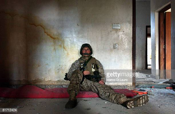 S Marine from the 1st US Marines Expeditionary Force 1st Battalion 3rd Marines Regiment Bravo Company sits on the floor as he is trapped in a...