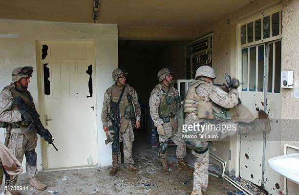 S Marine from the 1st US Marines Expeditionary Force 1st Battalion 3rd Marines Regiment Bravo Company attempts to kick down a door November 13 2004...