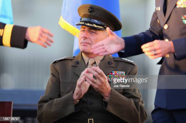 S Marine General John F Kelly looks on as US Army General Martin E Dempsey Chairman Joint Chiefs of Staff shakes hands with the outgoing commander US...