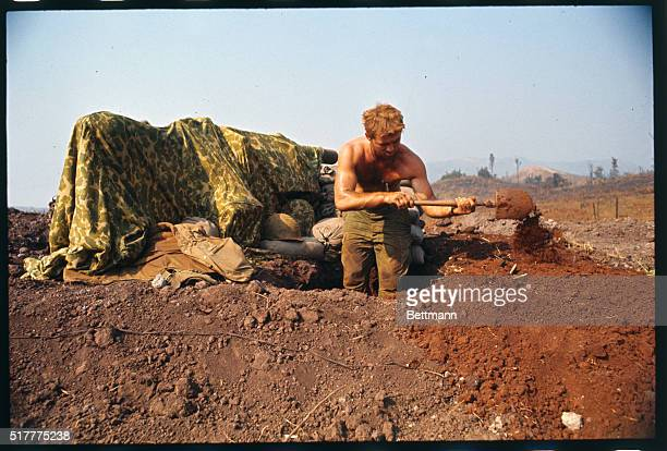 Marine George Johnson of Heuvelton NY digs in at this embattled outpost In left background is a camouflaged gun emplacement Khe Sanh's commander said...