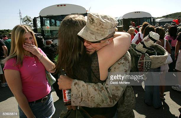 S Marine gets an emotional welcome from his family as he returns home from Iraq April 8 2005 at Camp Pendleton California The Marines of the 1st...