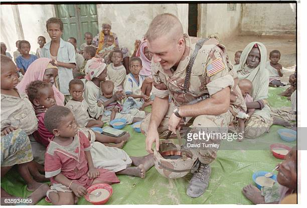 Marine greets a group of mothers with small children