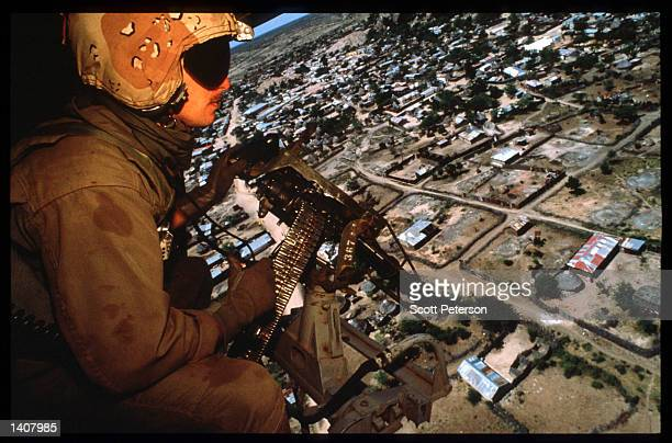 A marine guards a food convoy January 15 1993 in Bur Hakaba Somalia US troops arrived in 1992 marking the beginning of a UN peacekeeping mission...