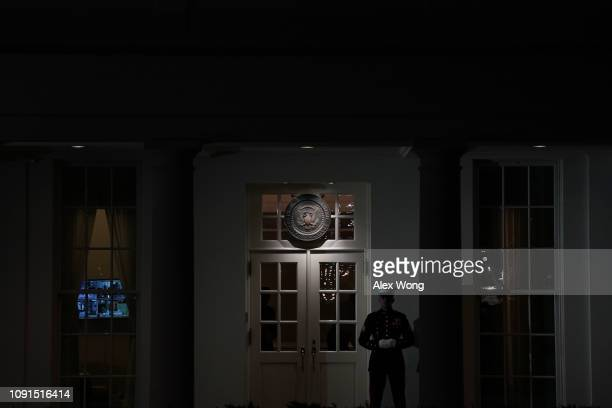S Marine guards the West Wing entrance of the White House January 8 2019 in Washington DC President Donald Trump is scheduled to give his first prime...