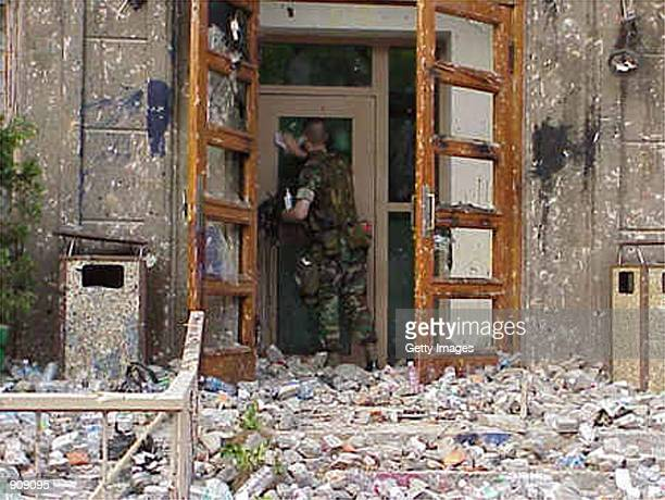 Marine Gunnery Sgt Stephen Austin inspects damage caused to the US embassy building in Beijing May 10 following two days of attacks by Chinese...