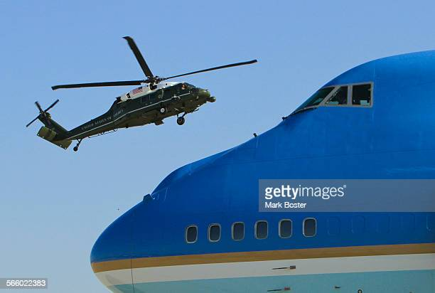 A Marine helicopter carrying President Barack Obama's staff comes in for landing above the nose of Air Force One shortly before the president...