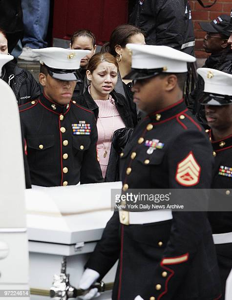 Marine honor guard carries the casket of Nixzmary Brown past mourners to a waiting hearse outside St Mary's Church on Grand St after her funeral...
