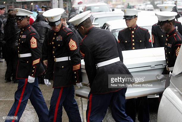 Marine honor guard carries the coffin of Nixzmary Brown inside St Mary's Church on Grand St for her funeral service The 7yearold girl was found dead...