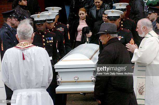 Marine honor guard carries the coffin of Nixzmary Brown past mourners to a waiting hearse outside St Mary's Church on Grand St after her funeral...