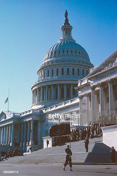 Marine honor guard carries the flag of the President of the United States in front of the East side of the Unites States Capitol Building during the...