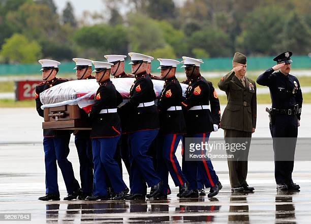 Marine honor guard carry the casket of LAPD SWAT officer and US Marine reservist Sgt Maj Robert J Cottle killed March 24 in a roadside bombing in...