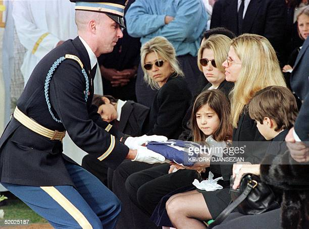 Marine honor guard presents Mary Bono the widow of Sonny Bono with the flag that covered Bono's casket during the burial ceremony in Desert Memorial...