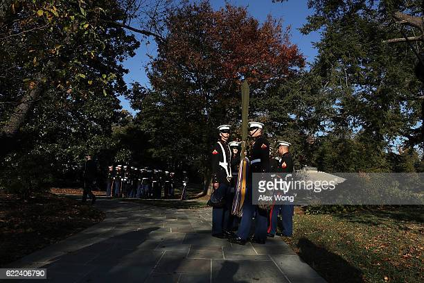 S Marine honor guards wait to participate in a wreathlaying ceremony at the Tomb of the Unknown Soldier at Arlington National Cemetery on Veterans...
