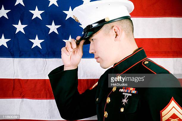 marine in front of a us flag - us military emblems stock pictures, royalty-free photos & images