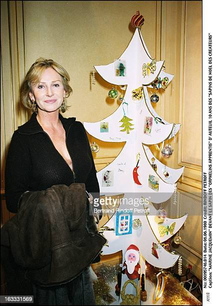 Marine Jacquemin in front of the christmas tree of Orphelins Apprentis from Auteuil 10th anniversary of Sapins De Noel Des Createurs woman
